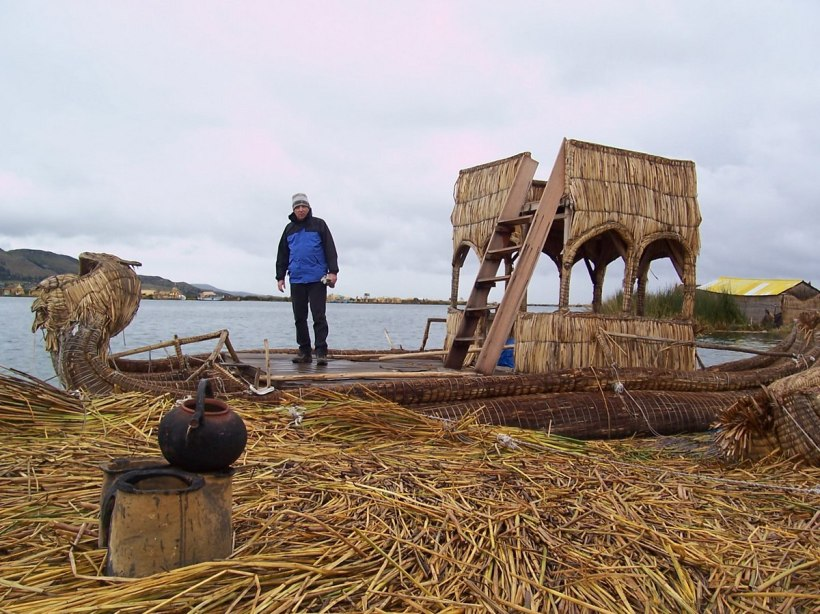 Bob standing on a Uros reed boat with a watchtower on Lake Titicaca in Peru, South America