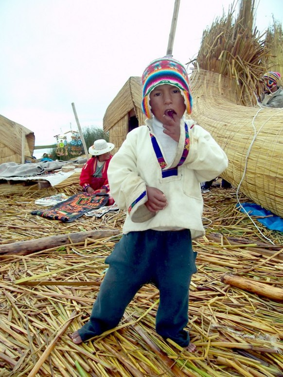 young uros boy, floating island, lake titicaca, peru