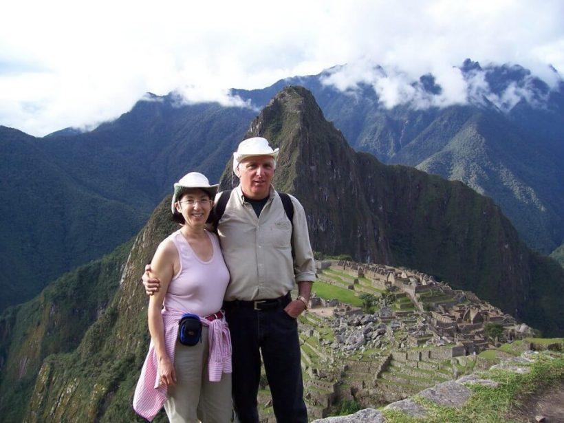 Bob and Jean standing on a ridge above Machu Picchu