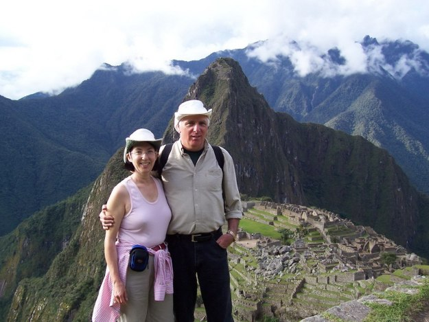 Bob and Jean standing on a ridge above Machu Picchu