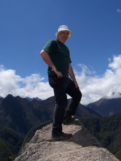Bob standing on the pinnacle of Huayna Picchu, at Machu Picchu