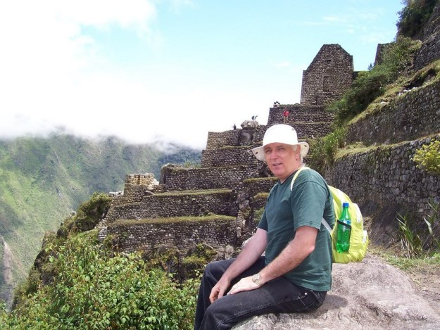 Bob sitting near the top of Huayna Picchu, at Machu Picchu