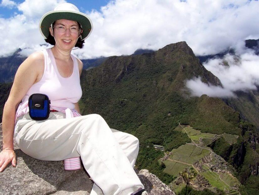Jean sitting on the pinnacle of Huayna Picchu, Machu Picchu