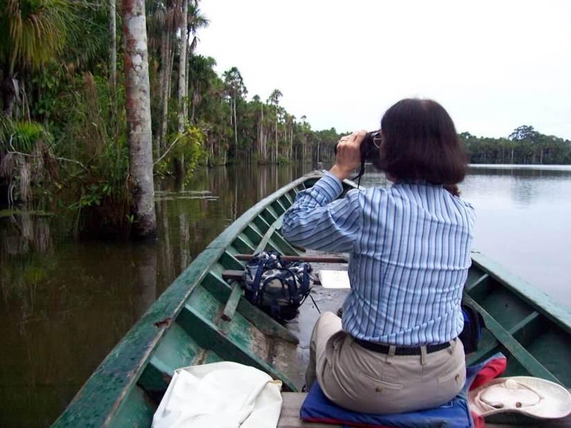 canoeing on lake sandoval - peru