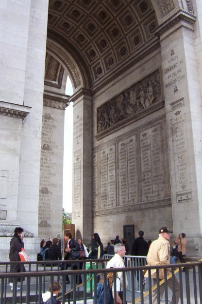 An image of the names of great battles and victories engraved under the great aches of the Arc de Triomphe, Paris, France.