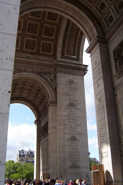 An image of names of great battles engraved on the attic of the Arc de Triomphe in Paris, France.