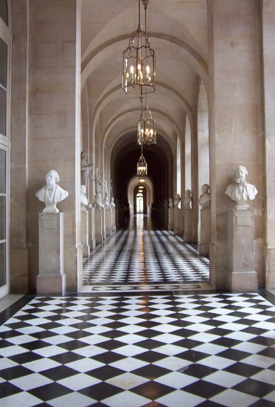 An image of a colonnade inside the Palace of Versailles in France.