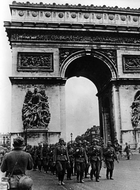 An image of German troops marching past the Arc de Triomphe in June 14, 1940.