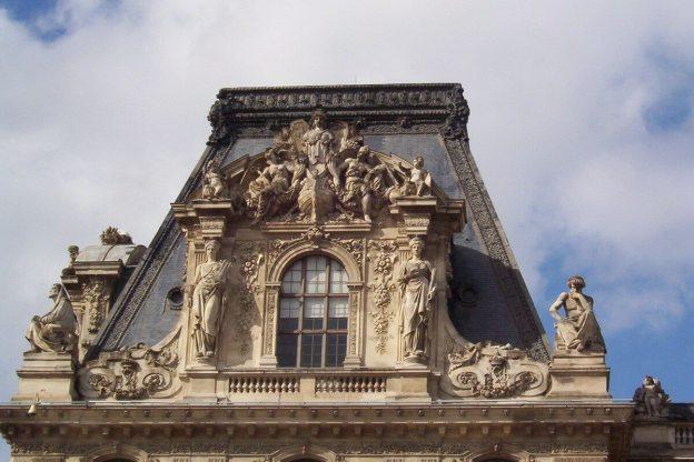 Louvre - stone carvings above windows - Paris - France