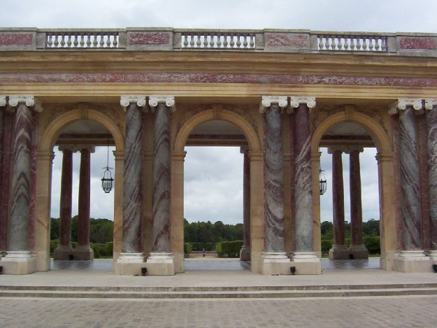 An image of the rose marble pilasters and columns at the Grand Trianon at Versailles in France.