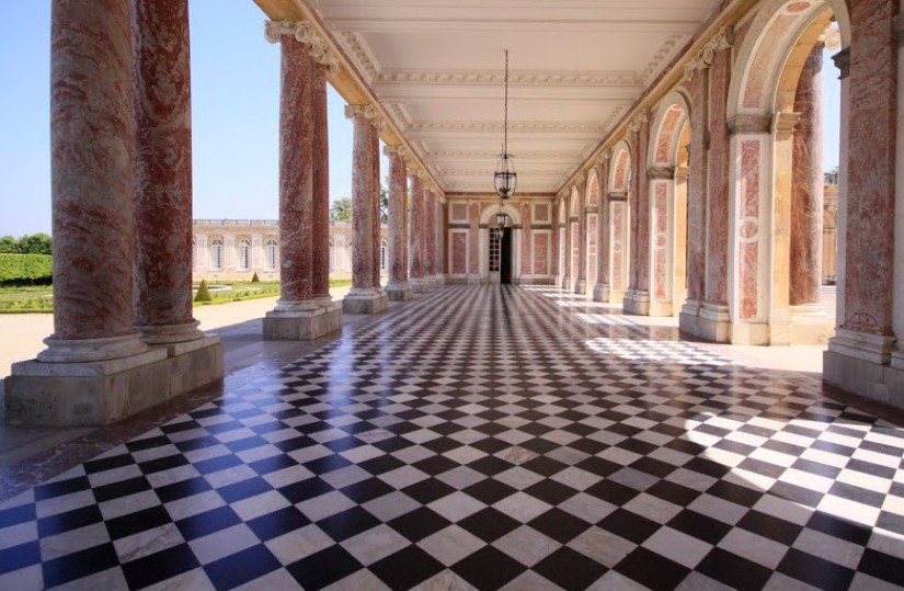 An image of the black and white checkerboard floor at the Grand Trianon at the Palace of Versailles in France.