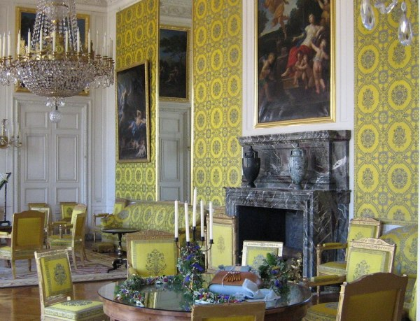 An image of the Yellow Room inside the Grand Trianon at the Palace of Versailles, France.