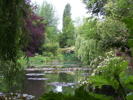 An image of Claude Monet's Water-Lily Pond in Giverny, France. Photography by Frame To Frame - Bob and Jean.