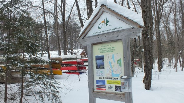 The main trail sign for the Beetle Lake hiking trail at Oxtongue Lake, Ontario.