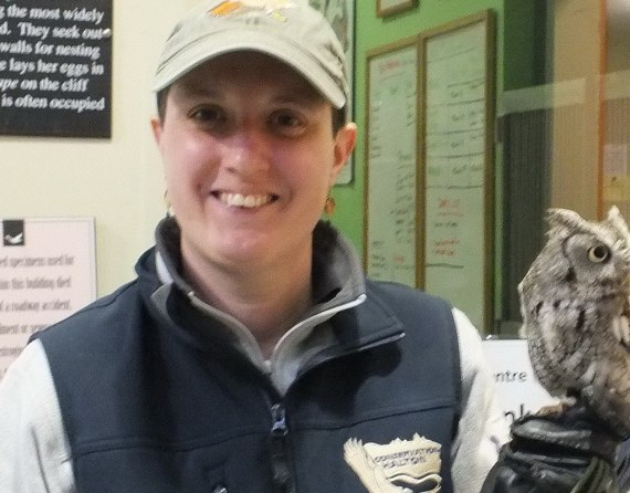Sandra holds a Eastern Screech Owl on her hand - Mountsberg Raptor Centre
