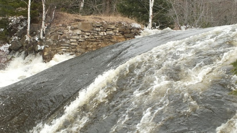 Marsh's Falls flooding - water gushing from beneath far rock bank - Oxtongue river - April 20 2013