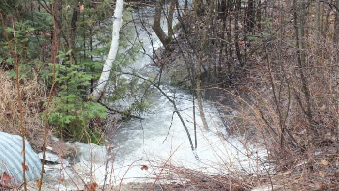 flood waters from stream - oxtongue lake - ontario april 19 2013