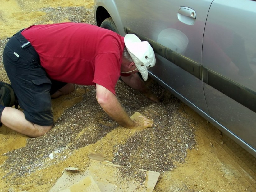 Bob digging car out of sand at Paracas National Reserve, Ica, Peru.