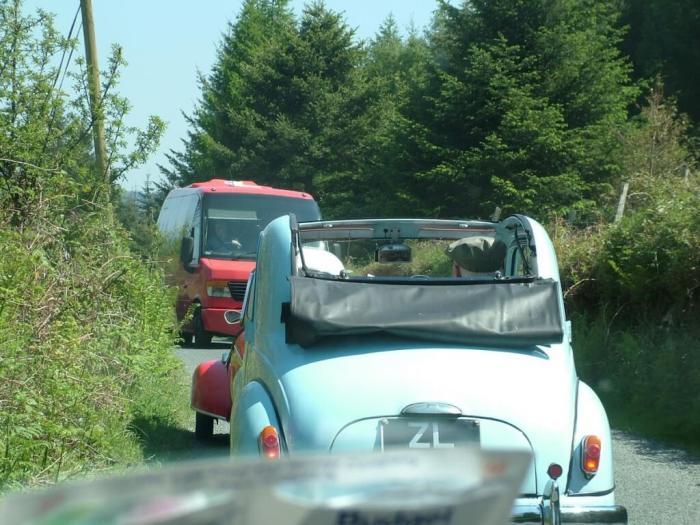 Red Messerschmitt KR- 175 microcar meets bus - Enniskerry - Wicklow - Ireland