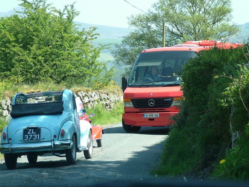 Red Messerschmitt KR- 175 microcar meets bus on tight road - Enniskerry - Wicklow - Ireland