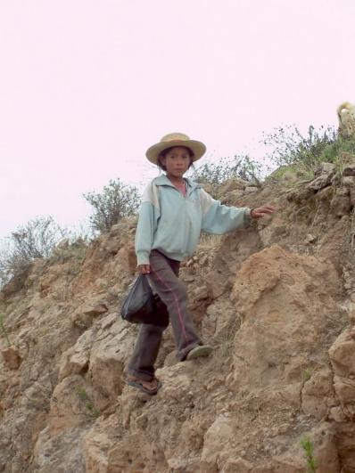 Young girl on a hillside near Nazca, Peru, South America
