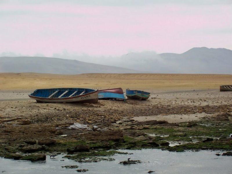 boats on desert shoreline at Lagunillas- national reserve of paracas - peru