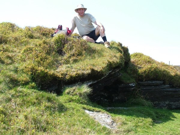 bob sits along the spinc hiking trail - wicklow mountains national park - ireland