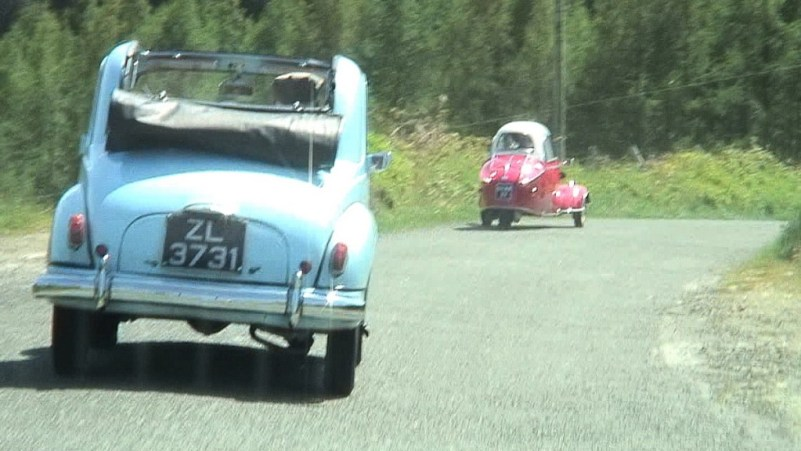 cars along country road - enniskerry - ireland