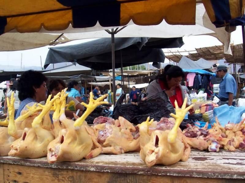 chickens for sale in street market - nazca - peru