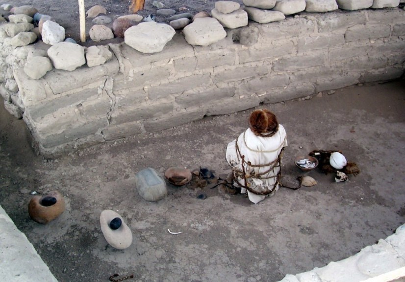 Human mummified body and skulls at the Chauchilla Cemetery in Peru, South America