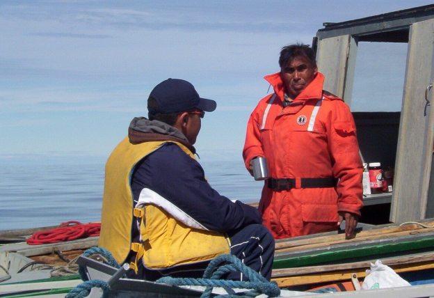 inuit drinking hot water - off baffin island - nunavut - canada