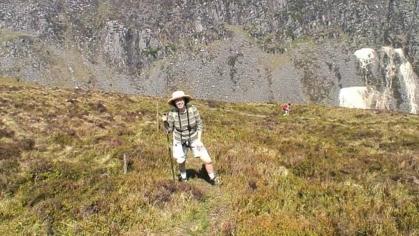 jean takes timeout climbing up to prezen rock - wicklow mountains national park - ireland