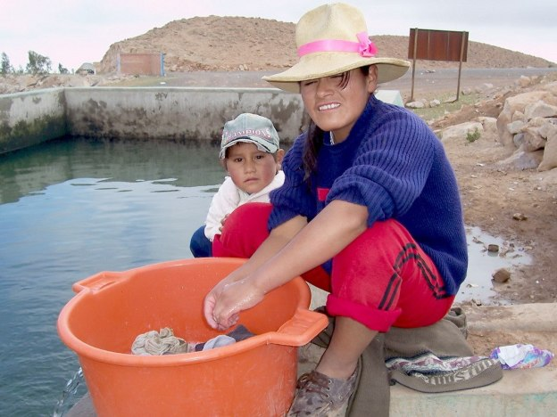 mother and son at Nuevo Santiago reservoir, Peru