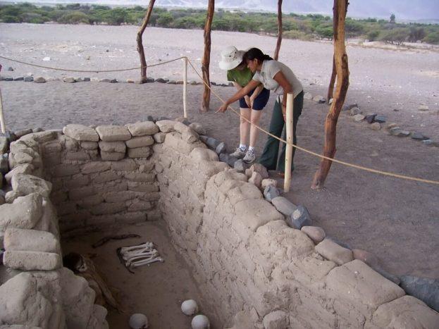 Jean views a burial plot at the Chauhilla Cemetery near Nazca in Peru, South America.