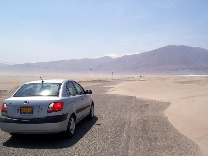 Sanddunes partially block pan american highway - peru - frame to frame