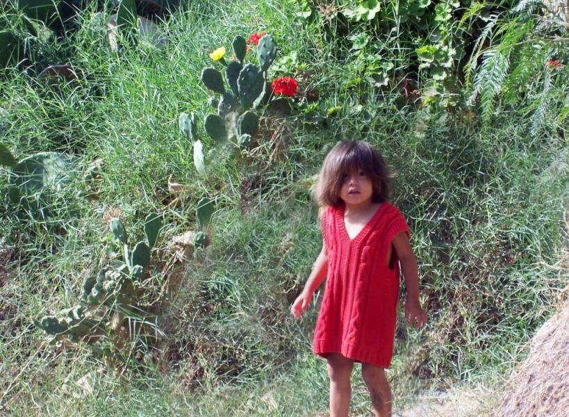 child in sand dune village - camana - peru