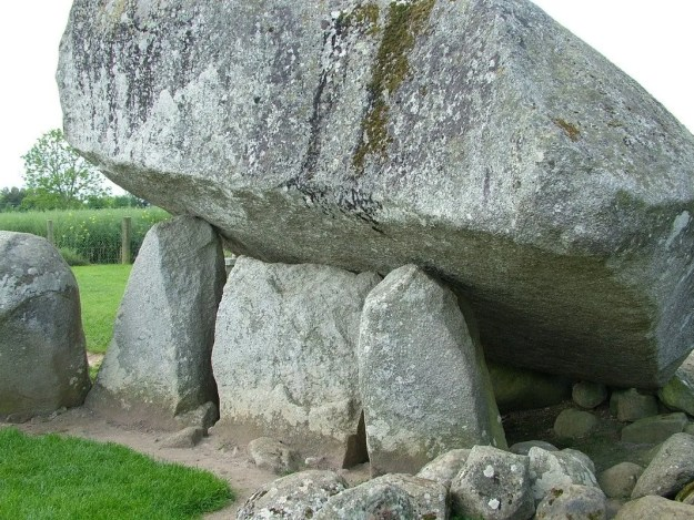 brownshill portal tomb - sideview of capstone held aloft by portal stones - county carlow - ireland