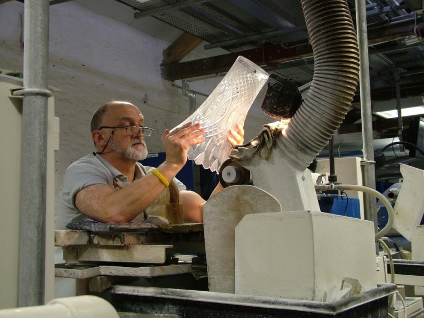 An image of a master cutter, cutting a vase at the Waterford Crystal factory in Waterford, Ireland. Photography by Frame To Frame - Bob and Jean.