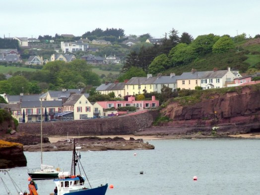colorful harbour homes at dunmore east in county waterford - ireland