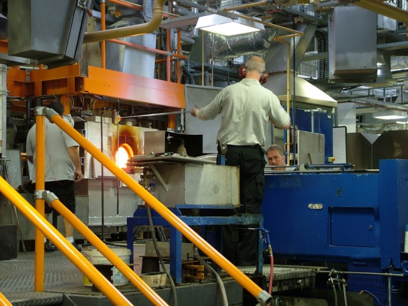 An image of glass blowers heating glass in the furnace at the Waterford Crystal factory in Waterford, Ireland. Photography by Frame To Frame - Bob and Jean.