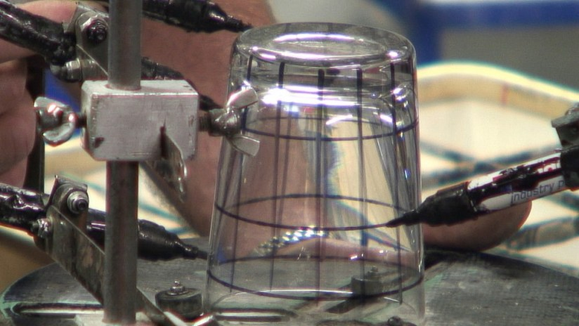 An image of a glass being ink marked for cutting at the Waterford Crystal factory in Waterford, Ireland. Photography by Frame To Frame - Bob and Jean.