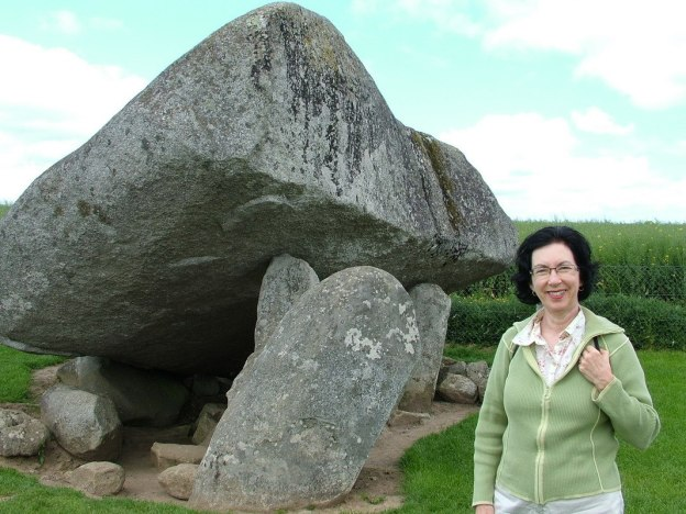 An image of Jean standing in front of the Brownshill Portal Tomb in County Carlow, Ireland.  Photography by Frame To Frame - Bob and Jean.