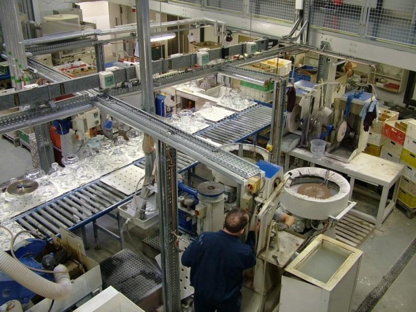 An image of a worker in the quality control room at the Waterford Crystal factory in Waterford, Ireland. Photography by Frame To Frame - Bob and Jean.