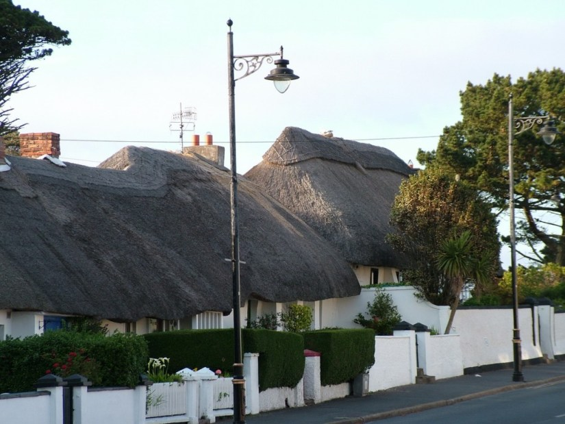 thatched roofs on homes at dunmore east in county waterford - ireland