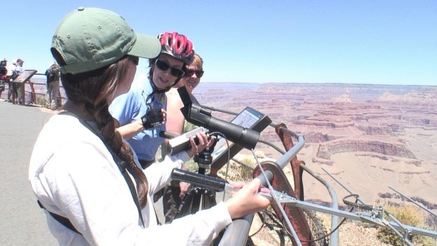 Jean listens to condor sounds at hopi point - grand canyon