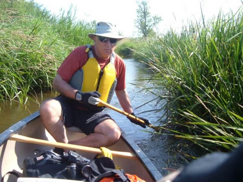bob canoeing through minesing wetlands, ontario