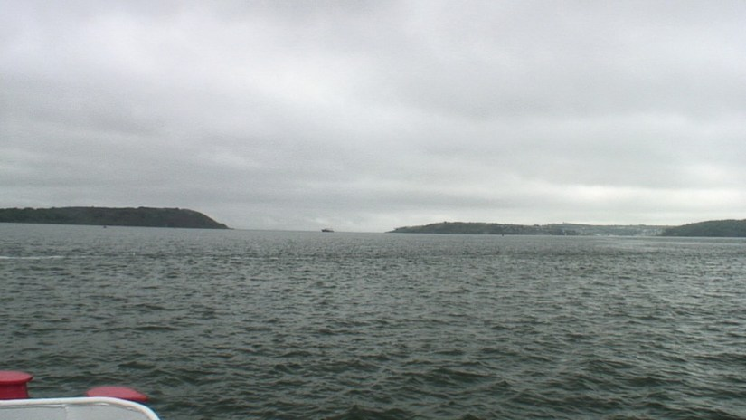 titanic's last anchorage spot, middle of picture where launch is located, off cobh town, county cork, ireland