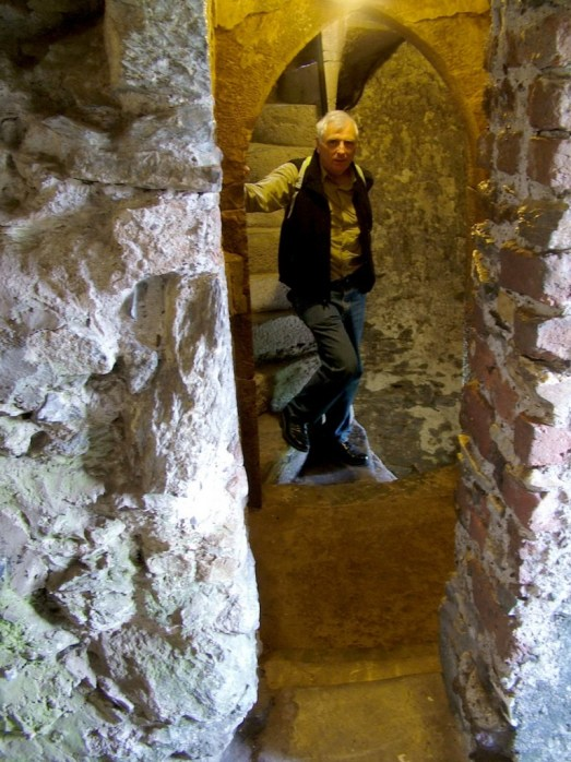 An image of Bob climbing the stone steps in the Blarney Castle tower near Cork in Ireland. Photography by Frame To Frame - Bob and Jean.