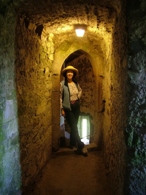 An image of Jean standing inside Blarney Castle near Cork in Ireland. Photography by Frame To Frame - Bob and Jean.