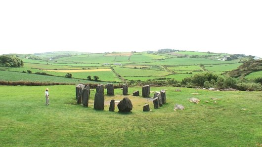 An image of Jean at the Drombeg Stone Circle looking towards the valley in County Cork, Ireland